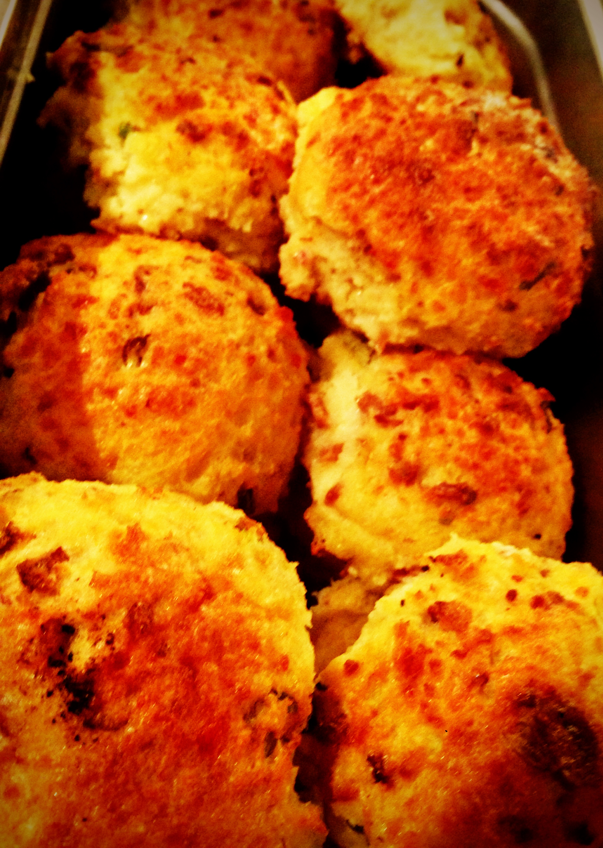 "Our fancy ""biscuits"", made from scratch with thick smoked bacon and cheddar cheese mixed into the batter, which are called ""Strata"" but we just call delicious!"